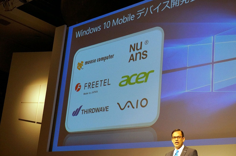 Microsoft-Japan-president-Takuya-Hirano-stands-in-front-of-a-slide-showing-the-logos-belonging-to-some-producers-of-Windows-10-Mobile-handsets.jpg.jpg